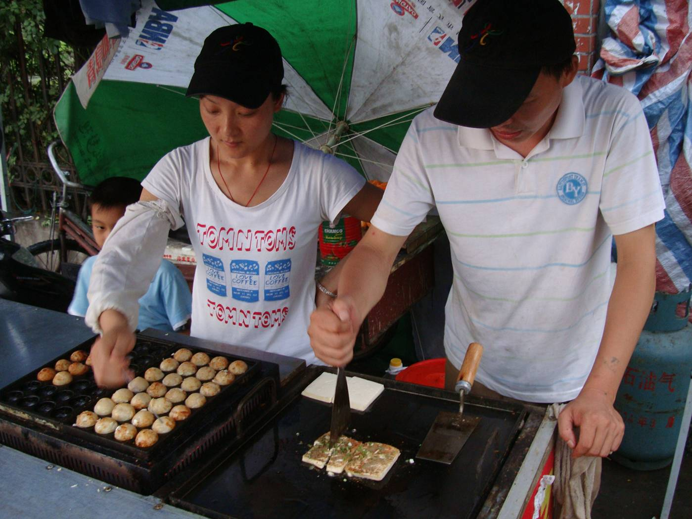 Picture:  Fish ball entrepreneurs on the streets of Shi Tang Cun, a village now part of Wuxi, China