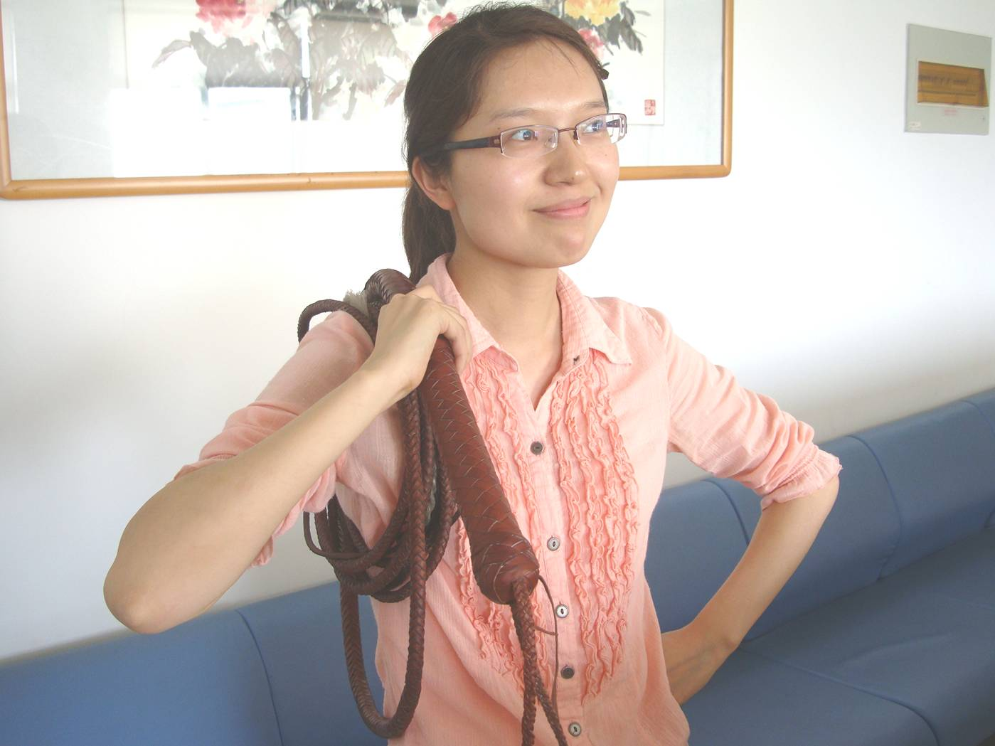 Picture:  There's nothing more stylish than an office worker with a sixteen foot bullwhip on her shoulder. Jiangnan University, Wuxi, China