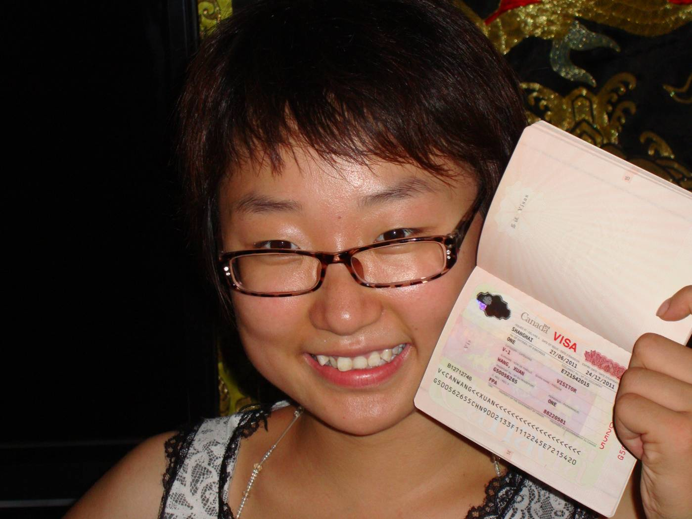 Picture:  Panda shows off her Canadian visa.  It took a major campaign by my friends and family to get it for her.  Jiangnan University, Wuxi, China