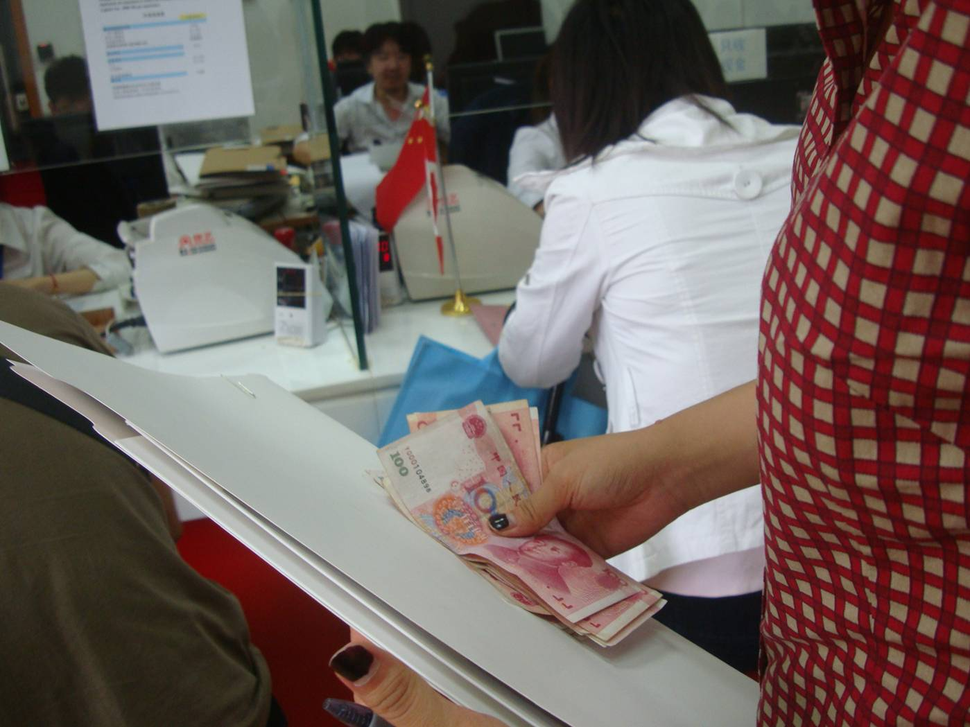 Picture:  Another 800 RMB goes into the cashier window as Panda applies again for a Canadian visa in Shanghai.