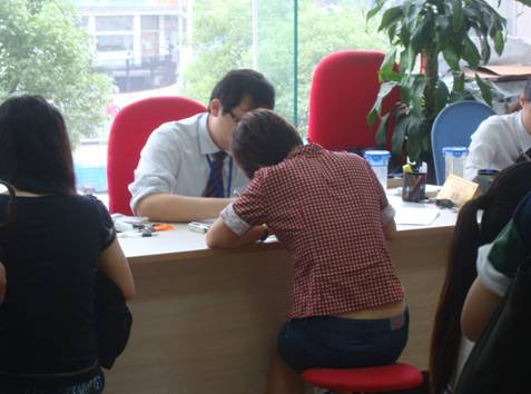 Picture:  Panda fills out yet more forms in the Canadian visa office, Shanghai.