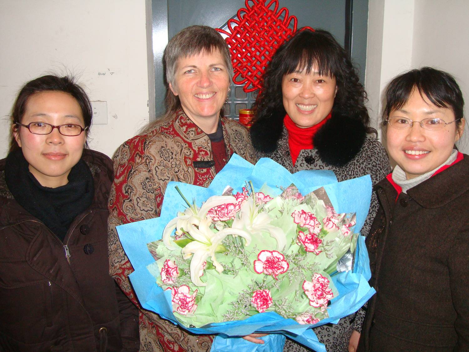 Ruth and the delegation from the administration, lead by Ms. Liu, with the beautiful bouquet for Women's Day.  Jiangnan University, Wuxi, China