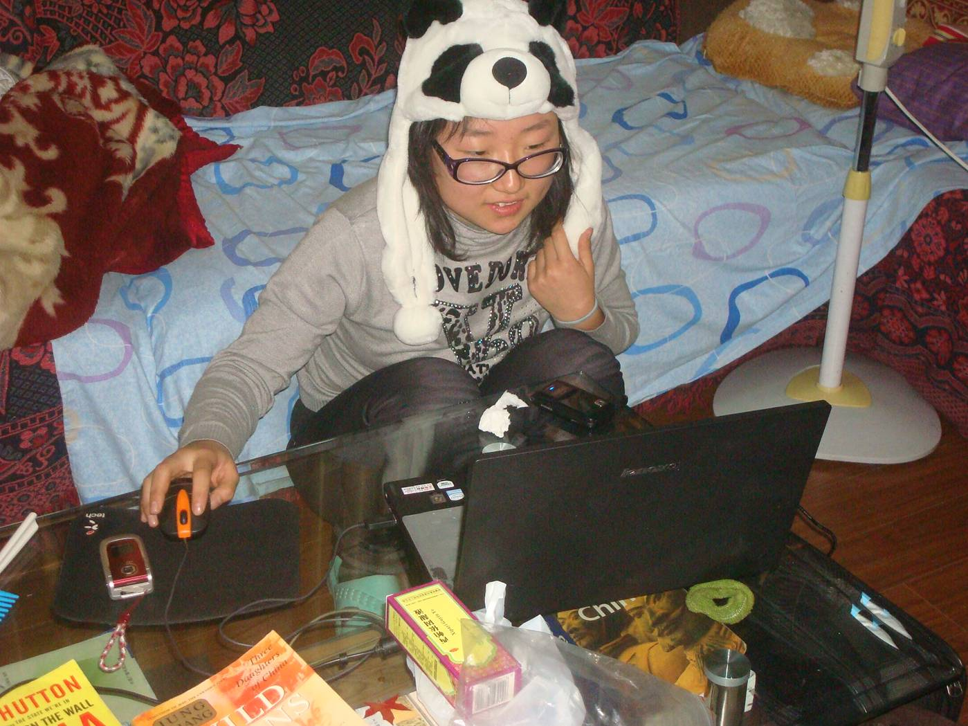 Panda wearing her panda hat and working hard.  Jiangnan University, Wuxi, China