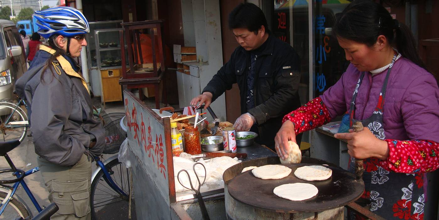 Ruth waits for the delicious pita pocket street food, Wuxi, China