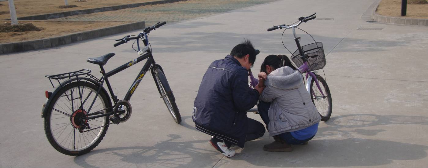 Picture:  Fortunately she only hurt her elbow.  This time.  I sure wish I could get these students to wear helmets.  Working on it.  Jiangnan University, Wuxi, China
