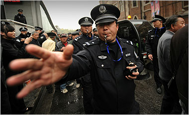 Policemen breaking up crowds in Shanghai on Feb. 27 after anonymous calls for protests circulated on the Internet. Picture stolen from the NT Times.