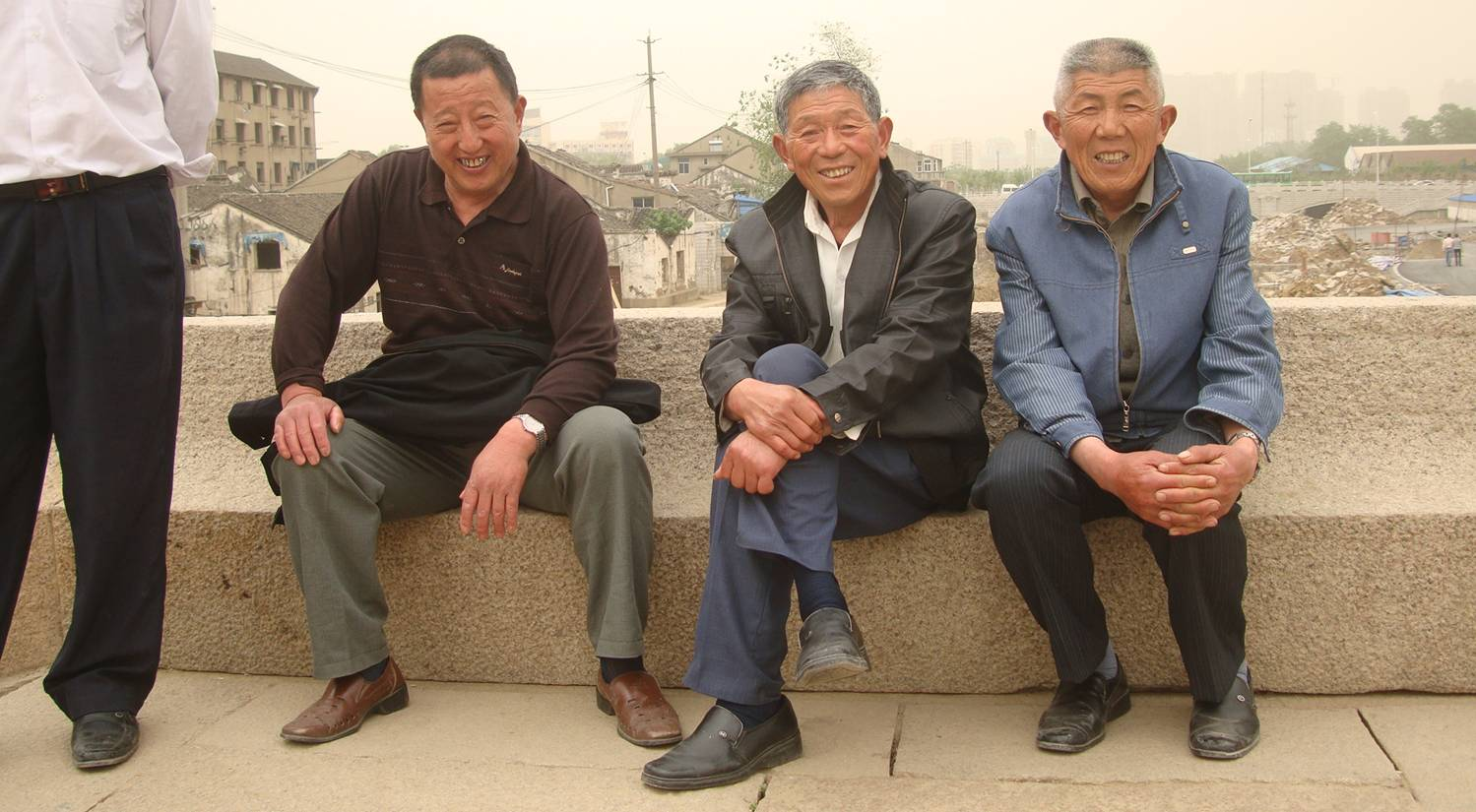 Picture:  Three gentlemen on the nicely designed bench on the bridge over the canal.  I didn't have the nerve to ask them to take the three monkies pose, though it would have made a great fun picture, just possibly insulting and racist.  Wuxi, China