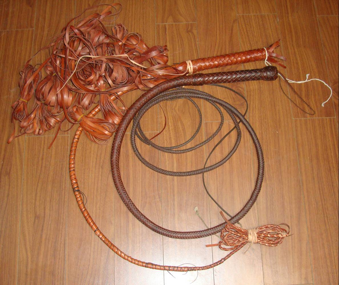 Picture:  The whip I bought in 1974, and the one I'm making with the belly complete and the handle platted.  Wuxi, China