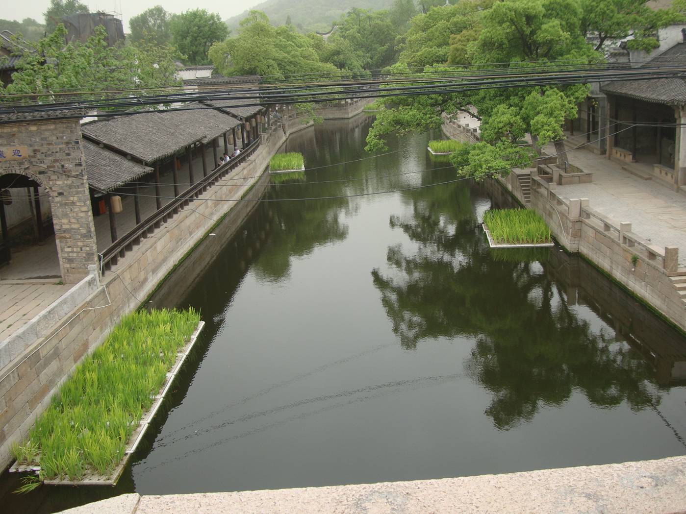 Picture:  Looking West from the bridge and the canal is completed through the renovated ancient city.  Wuxi, China