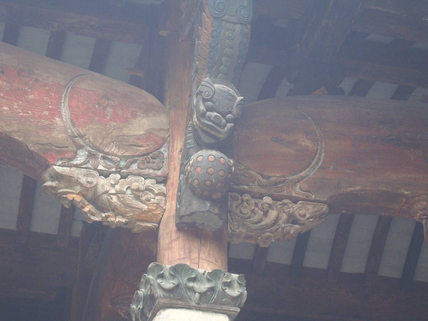 Picture: You miss a lot if you don't look up.  Carved roof support knees in the Wuxi museum.  Wuxi, China