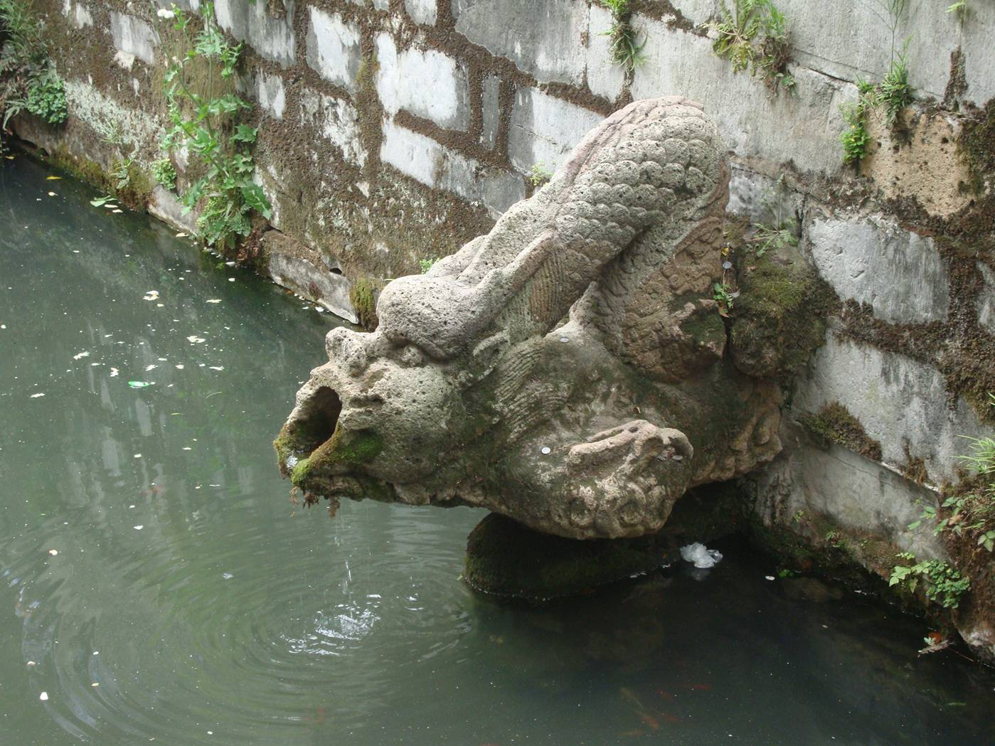 Picture:  A dragon mouth fountain in Xi Hui Park,  Wuxi, China.  Hard to know how old some of these things are.  Could be centuries, or could be a couple of years.