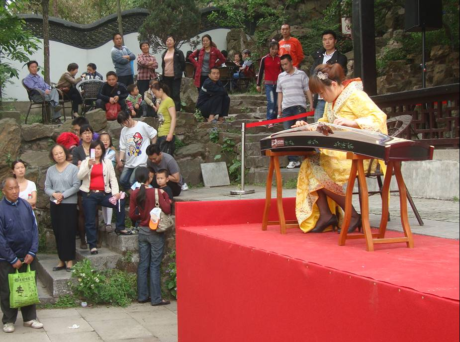 Picture: A Guzheng musician gives a free concert.  Xi Hui Park,  Wuxi, China