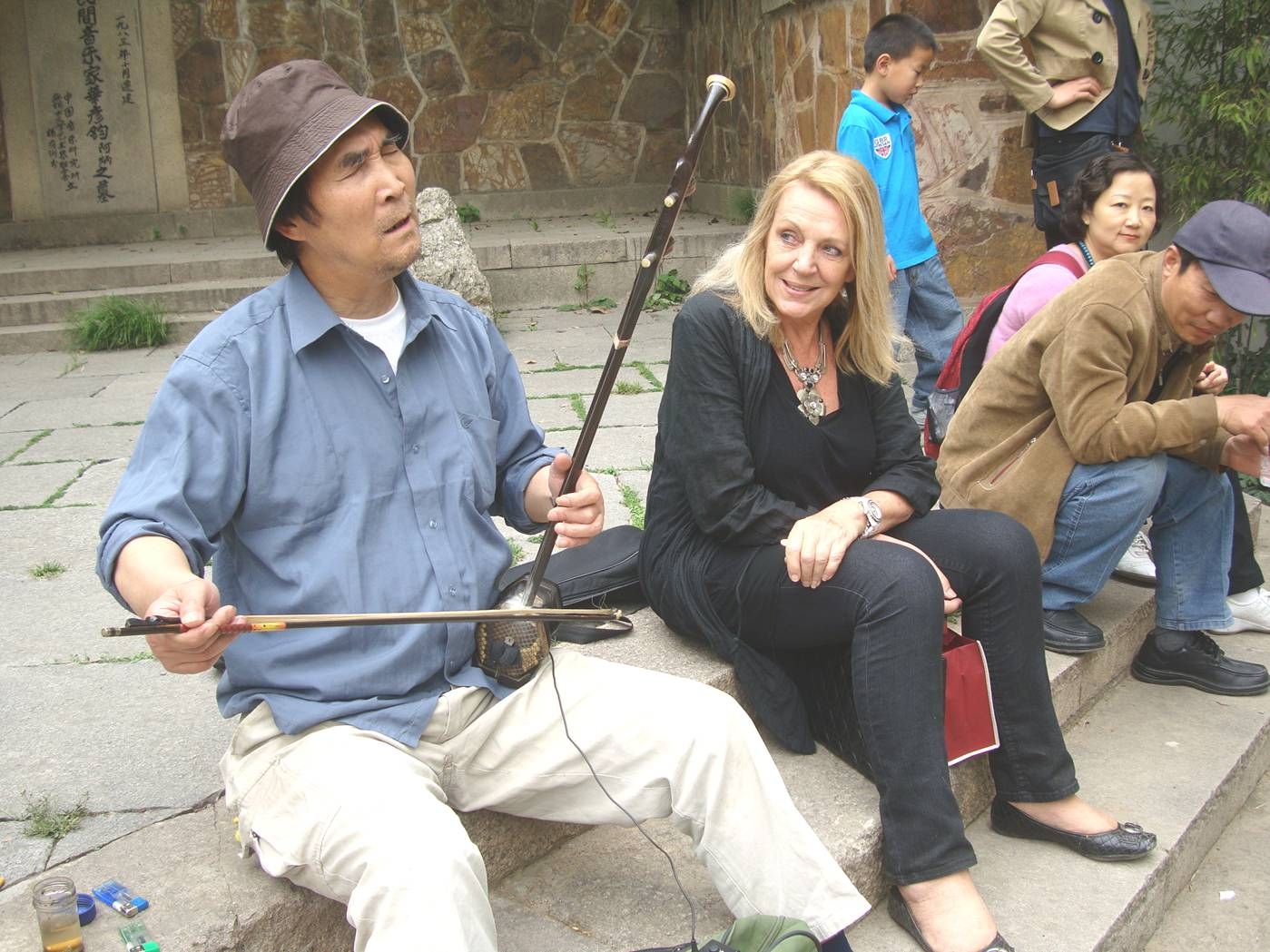 Picture:  He wasn't the greatest erhu player I've ever heard, and he should have avoided western tunes, but he gets full points for performance facial expressions.  Xi Hui Park, Wuxi, China