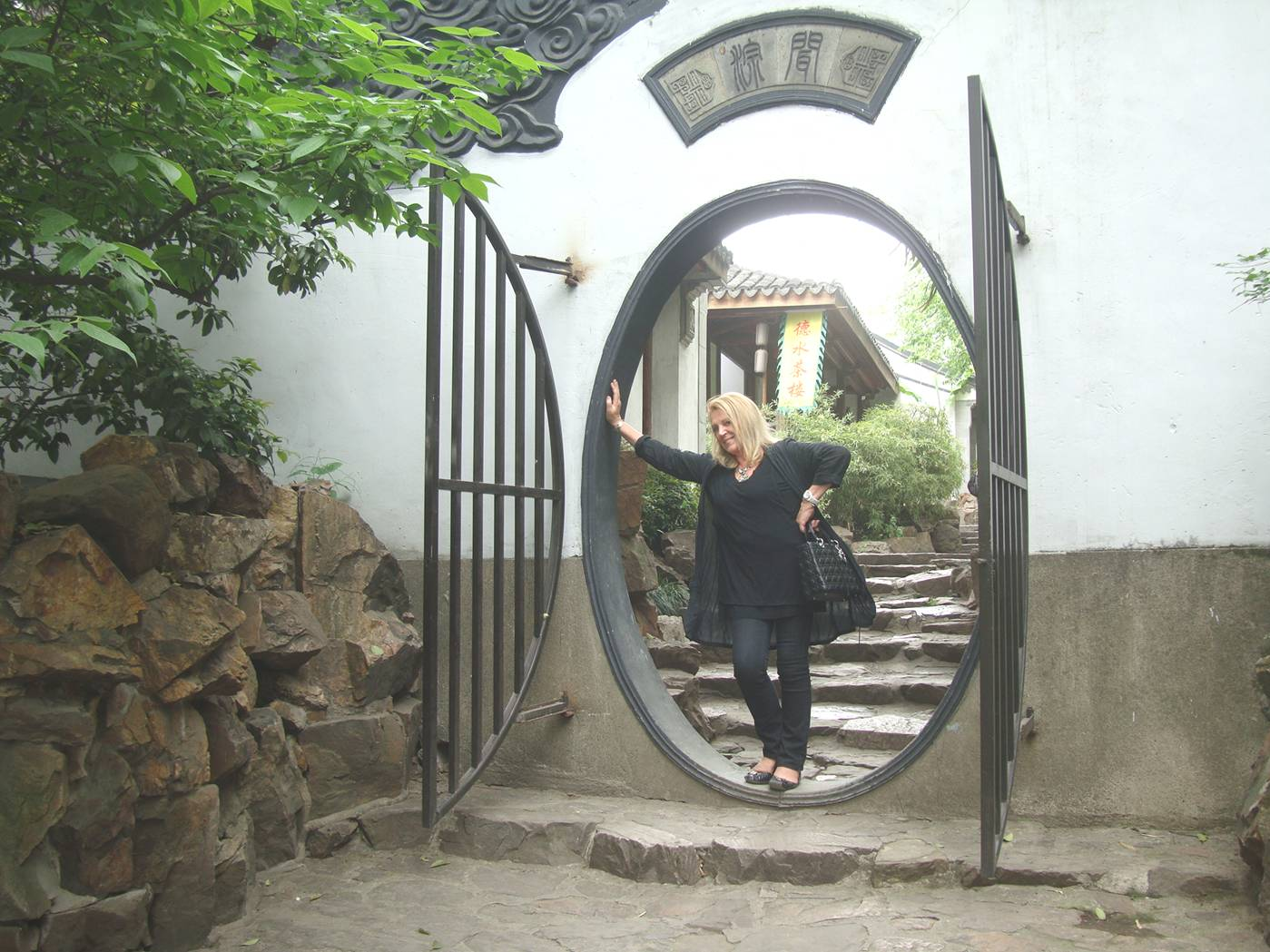 Picture:  Our wonderful Australian friend, Marion, camps it up in the round gateway.  Xi Hui Park, Wuxi, China