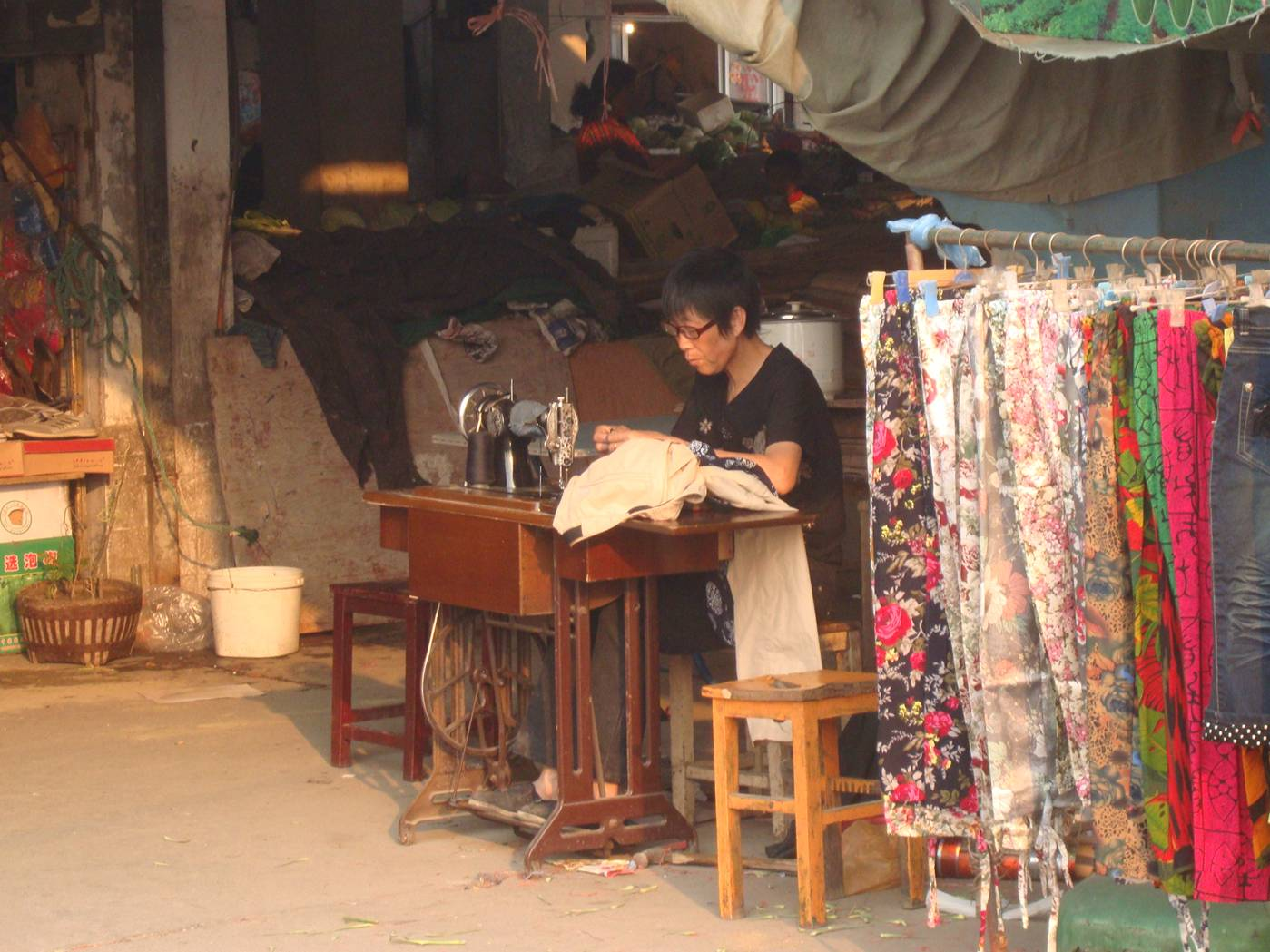 Picture:  No electric power required.  A seamstress at work in Shi Tang Cun, near the Jiangnan Univeristy campus.  Wuxi, China