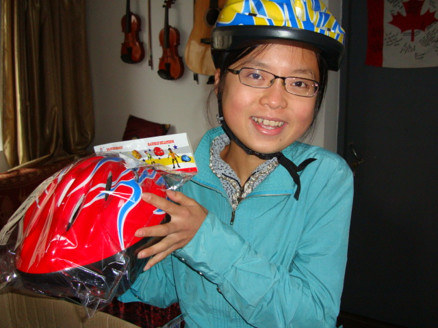 Gu Sheng with helmets.  She's really the first student to wear one at Jiangnan University,  Wuxi,  China