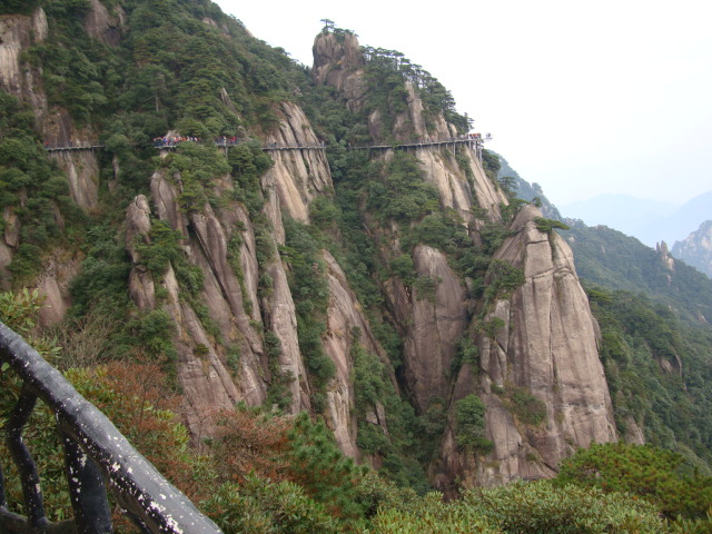 Four kilimeters of sidewalk snaking around the shear cliffs of  San Qing Shan,  Jiangxi Province,  China