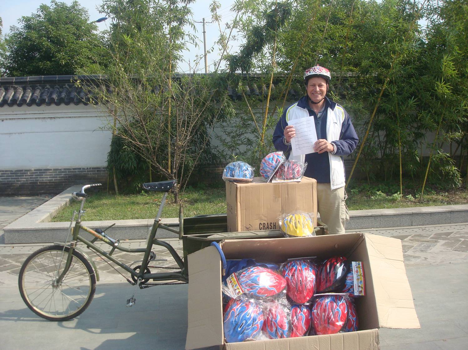 Not what I expected to be doing in China,  but worth doing.  Promoting bike helmets at the North gate,  Jiangnan University,  Wuxi,  China