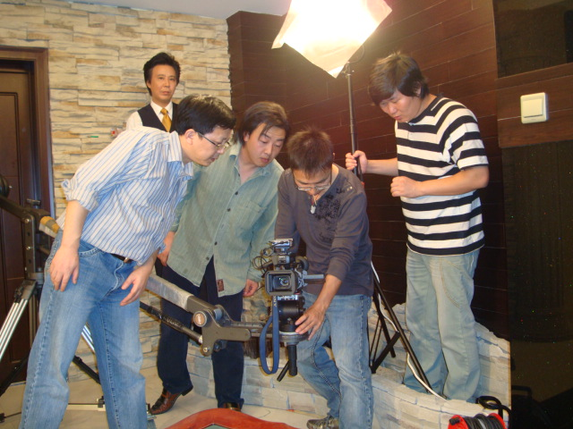 A minimal film crew at work on an industrial short,  Wuxi,  China.