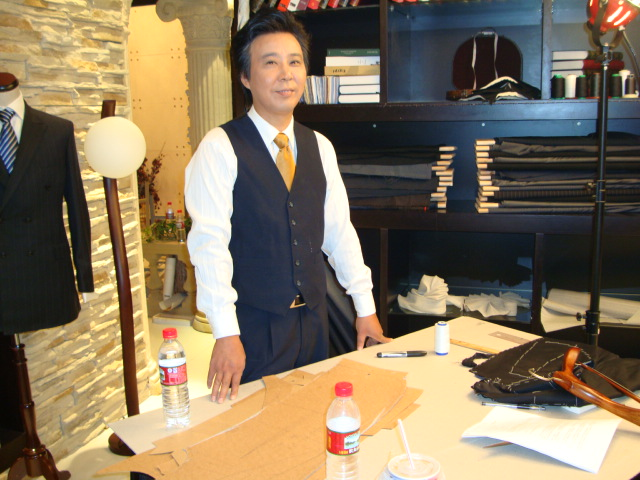 The real deal,  a Chinese master tailor standing by for technical advice and close up work.