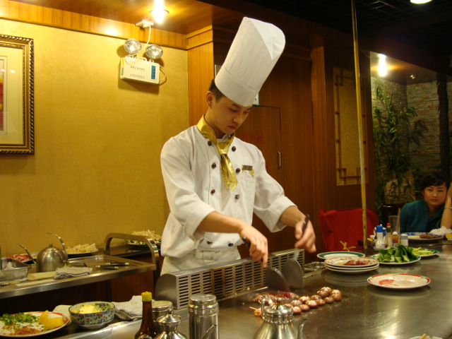 Grill chef and performance artist at Shanghai Tepanyaki,  Wuxi,  China