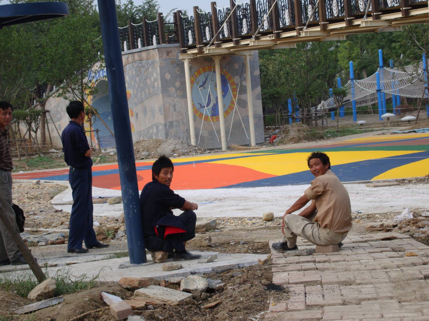 Workmen take a break from building the children's play area,  Taihu Park,  Wuxi, China