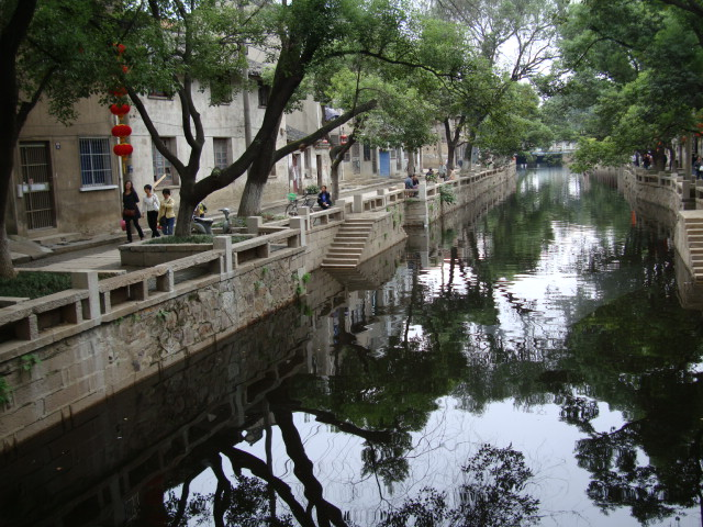 Canal in the newly restored old city,  Wuxi,  China