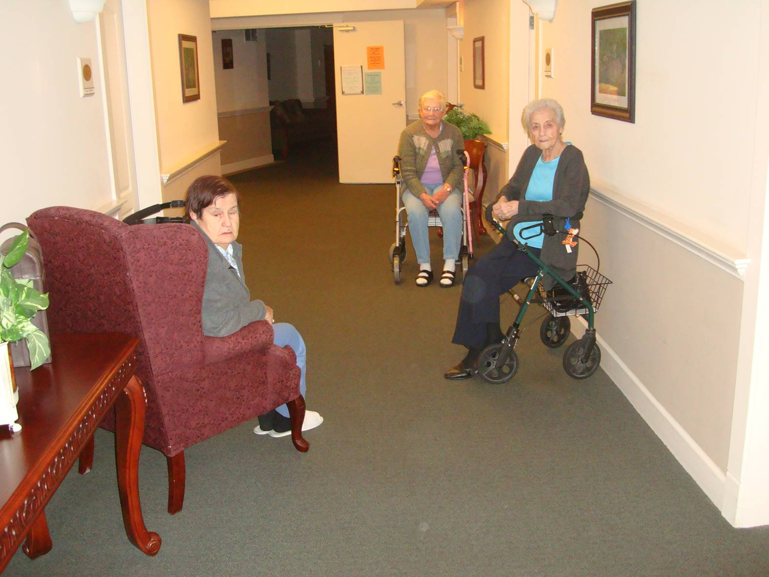 picture:  Mother holds court in the hallway with her friends in the assisted living home.  Maple Ridge, B.C.