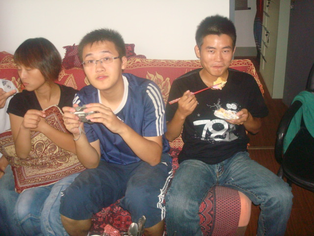 Winkle,  George, and Fonzie eating cake at Ruth's birthday party,  Jiangnan University,  Wuxi,  China.
