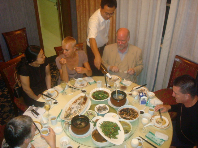 Michael Bian refreshes the beer, Jiangnan University faculty dinner laid on by the Foreign Languages Department
