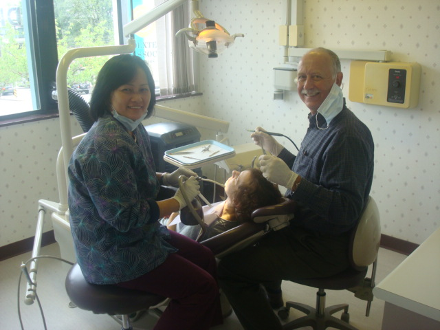 Dr. George Porteous,  dentist, at work,  Vancouver,  Canada