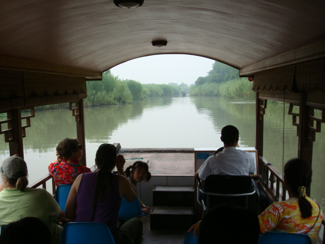 a boat ride through the reeds,  Shanghu Lake,  Jiangsu,  China