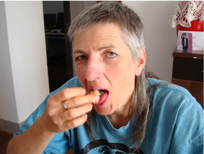 Picture: Ruth eats lobster.  Check out the picture over her left shoulder.