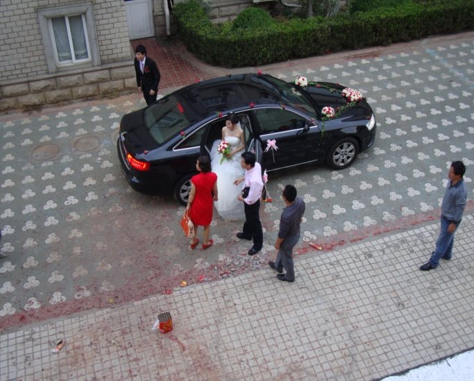 Picture: The Bride and Groom arrive at their wedding amid the firworks litter.