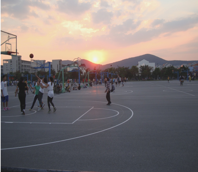 Picture:  Students make full use of the last daylight on the basketball courts.