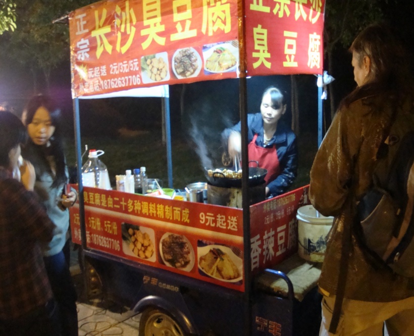 Picture:  This lady sells the best chou doufu (stinky tofu) in China.  Delicious.  Not good for you.