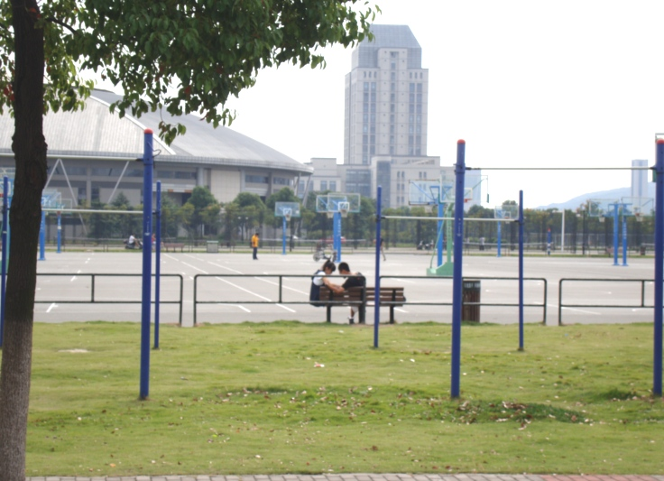 Picture: Lovers by the almost deserted basketball courts.