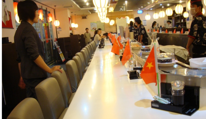 Picture:  Chinese flag at every place setting in the Japanese restaurant.  More flags than customers.