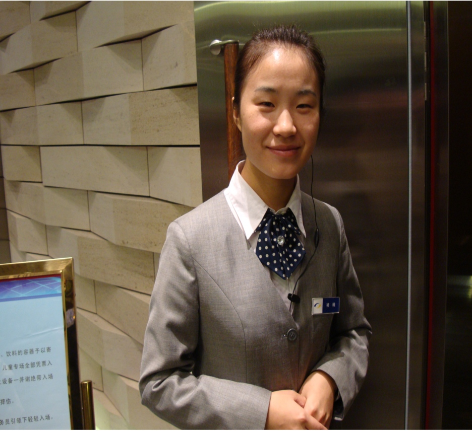 Picture:  She's an usherette, but she functions more as a guard.  No cameras, food, drinks, or backpacks allowed.