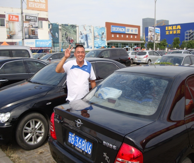 Picture:  Xiao He drives us places and waits while we shop.