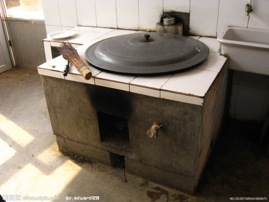 Picture: Cooking Stove.  Under the lid is a huge wok.  Bellows at the side stoke the fire.