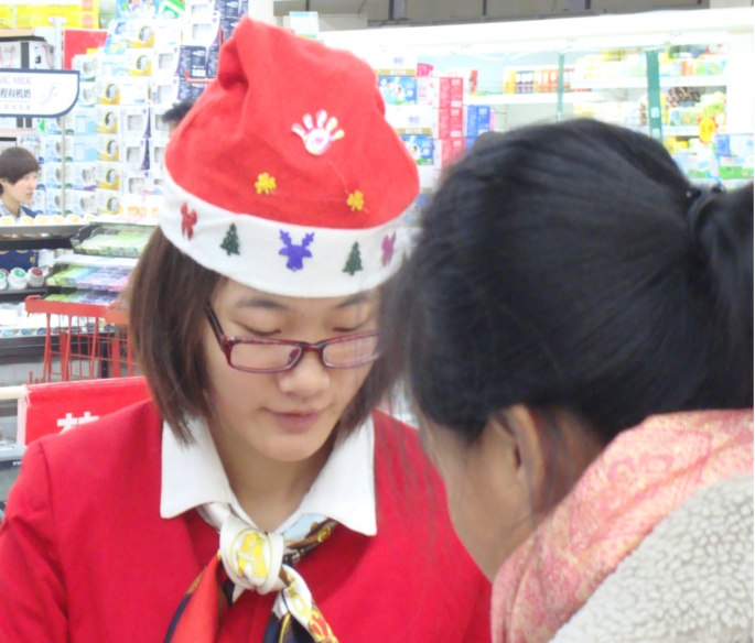 Picture: Mrs. Santa did our checkout at our local supermarket.  Wuxi, China