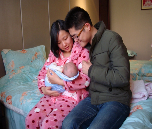 Picture: Lu Ying and Wang Tao with baby Wang Jia Ying, Wang + Ying.