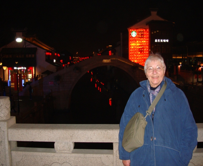 Picture:  We took Ruth's mom down to Nan Chan Si, the tourist area.  Here she is on a bridge over the canal.  Wuxi, China