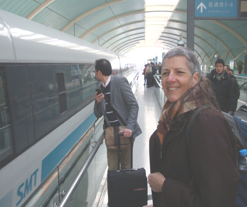 Picture:  Ruth ready to board the Maglev in Shanghai, China.