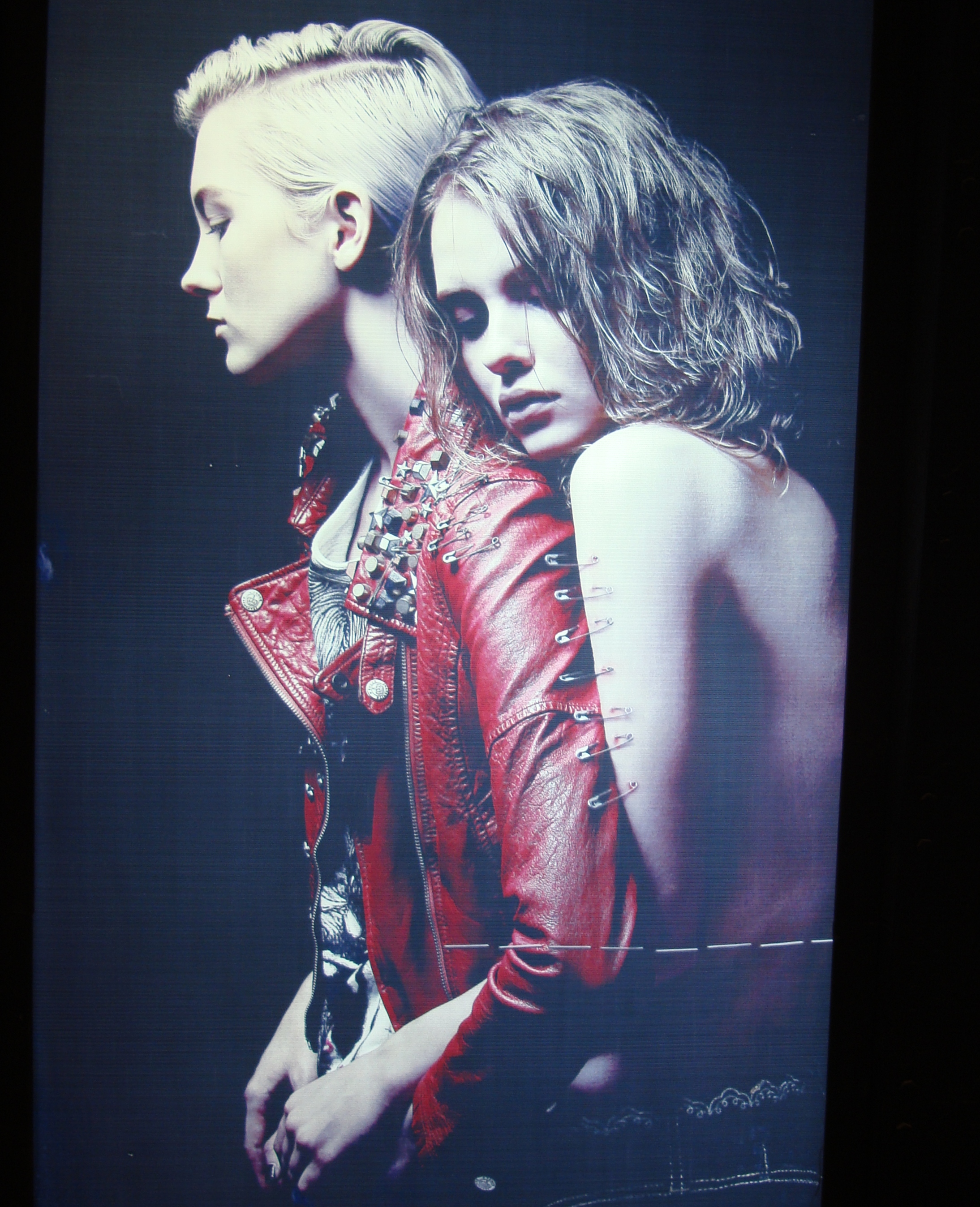 Picture: Somewhat disturbing S&M poster advertising clothing and a lifestyle. Shanghai, China