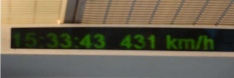 Picture:  The maglev gives a running update on it's speed, which at this point was 431 km/hr.  Awesome.  Shanghahn, China