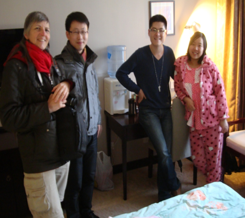 Picture:  Ruth, William, Wang Tao and Lu Ying in the club for new mothers.