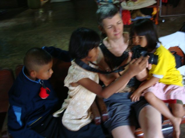 Picture:  Kids everywhere love a digital camera.  Baan Maa Naam,  Sangkhlaburiy, Thailand