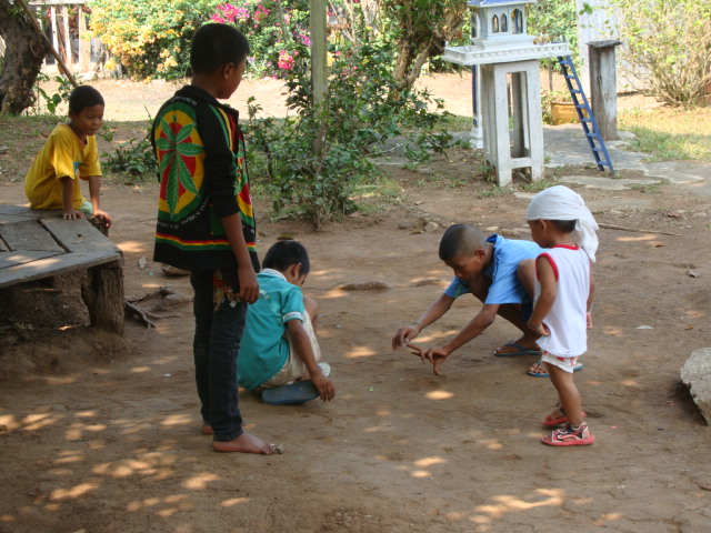 Picture:  Children at play outside Naam's House, Sangkhlaburi, Thailand